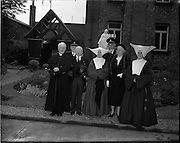 14/05/1957<br /> 05/14/1957<br /> 14 May 1957<br /> St Agatha's Daughters of Charity convent in North William Street, commemorating their centenary, Dublin. Sean T. O'Kelly, President of Ireland, with the Mother Lepicárd, Superior General of the Daughters of Charity. (l-r Front row) are: Monsignor O'Reilly P.P. of St. Agatha's; Sean T. O'Kelly; Mother Lepicárd and Mrs. O'Kelly.