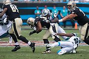 JeremyCash(57) tackles Mark Ingram(22) in the New Orleans Saints 34 to 13 victory over the Carolina Panthers.