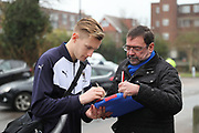 AFC Wimbledon striker Joe Pigott (39) signing autographs during the EFL Sky Bet League 1 match between AFC Wimbledon and Blackpool at the Cherry Red Records Stadium, Kingston, England on 20 January 2018. Photo by Matthew Redman.
