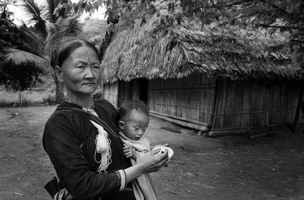 A Lanten woman with child near Luang Namtha, Laos.