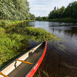 A canoe on the banks of the Mattawamkeag River in Wytipitlock, Maine.