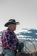 Lyle Woosley, 79 yrs, helping neighbor,  Hamm Ranch, branding. Wilsall, MT