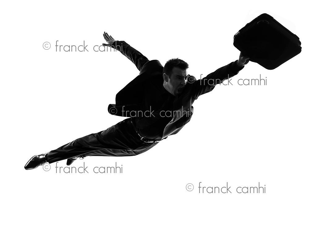 one caucasian business super man flying in silhouette on white background