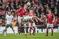 FOOTBALL: Andreas Cornelius (Denmark) jumps above James McClean (Ireland) during the World Cup 2018 UEFA Play-off match, first leg, between Denmark and the Republic of Ireland at Parken Stadium on November 11, 2017 in Copenhagen, Denmark. Photo by: Claus Birch / ClausBirch.dk.