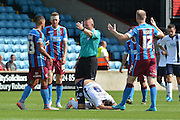 fouls by Jack King  on Lee Gregory  during the Sky Bet League 1 match between Scunthorpe United and Millwall at Glanford Park, Scunthorpe, England on 22 August 2015. Photo by Ian Lyall.