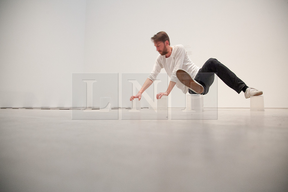 """© London News Pictures. 22/02/2013. Margate, Kent. Artist Matthias Sperling performs his work """"To Hand"""" at the Turner Contemporary in Margate, Kent. Matthias Sperling is part of the Siobhan Davies Dance group and whose performance involves balancing on everyday objects whilst moving around the gallery containing Carl Andres """"Mass and Matter exhibition also on at the gallery. Photo credit should read Manu Palomeque/LNP."""