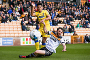 AFC Wimbledon forward Lyle Taylor (33) wins the corner off Port Vale defender Kjell Knops  (5)  during the EFL Sky Bet League 1 match between Port Vale and AFC Wimbledon at Vale Park, Burslem, England on 1 April 2017. Photo by Simon Davies.