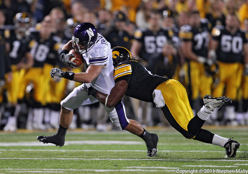 October 15, 2011: Northwestern Wildcats wide receiver Jeremy Ebert (11) is hit by Iowa Hawkeyes defensive back Jordan Bernstine (4) during the second half of the NCAA football game between the Northwestern Wildcats and the Iowa Hawkeyes at Kinnick Stadium in Iowa City, Iowa on Saturday, October 15, 2011. Iowa defeated Northwestern 41-31.