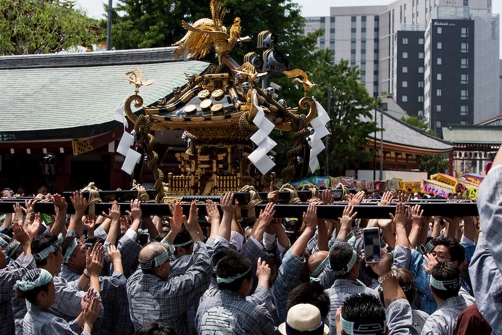 TOKYO, JAPAN - MAY 14: The residents of Asakusa band together to carry a 'mikoshi' shrines in front of in Senso-ji Temple in Asakusa, Tokyo on May 14, 2016. These mikoshi (portable shrine) is carried in the streets of Asakusa to bring luck, blessings and prosperity to the area and its inhabitants.<br /> <br /> Photo: Richard Atrero de Guzman