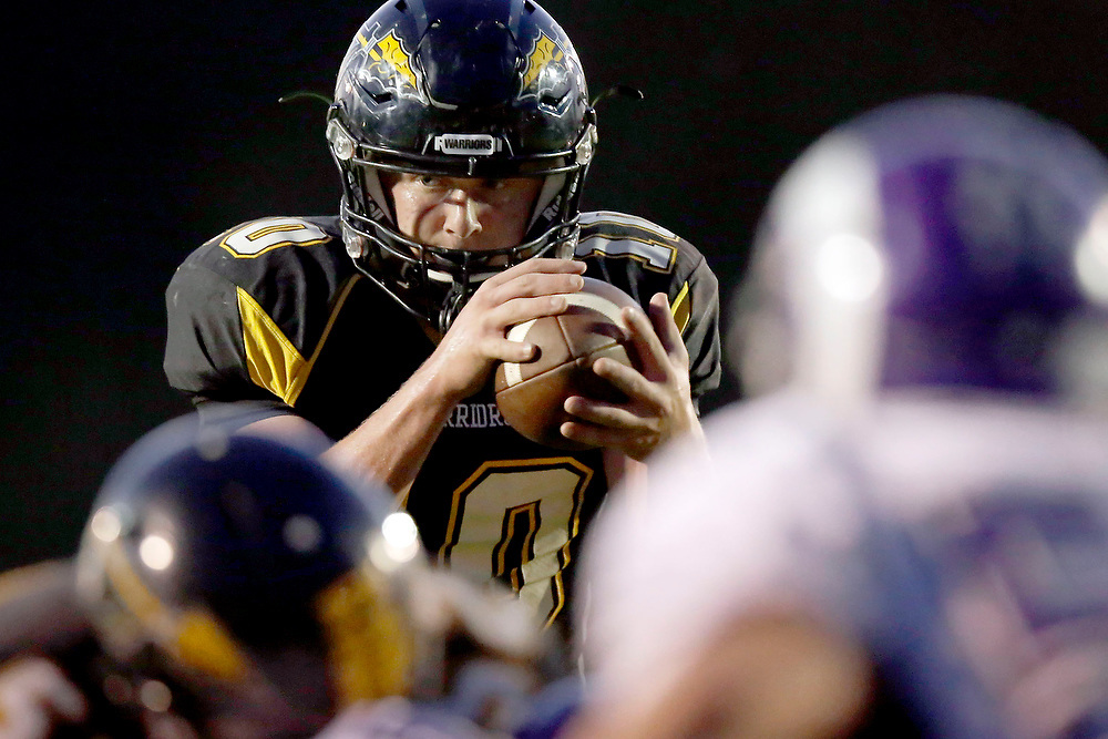 Tuscola's Nick Bates (10) looks for an open play while taking the snap against Shelbyville during the first half of a high school football game Friday, Sept. 19, 2014, at Tuscola High School in Tuscola, Ill. (Lee News Service/ Stephen Haas)