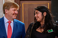 AMSTERDAM - King Willem-Alexander with artist Raquel van Haver. King Willem-Alexander during the ceremony of the Royal Prize for Free Painting 2018 in the Royal Palace. copyrught robin utrecht