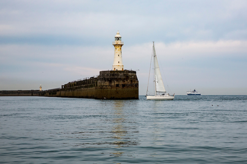 A white sail boat sails past Dover Breakwater Lighthouse, leaving Dover harbour in the early morning, Kent, England, United Kingdom. A large ferry boat is also returning to the port.  (photo by Andrew Aitchison / In pictures via Getty Images)