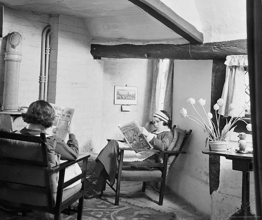 Maids Reading the Papers at Holland's Heath farm, Billingshurst, Sussex, England, 1935