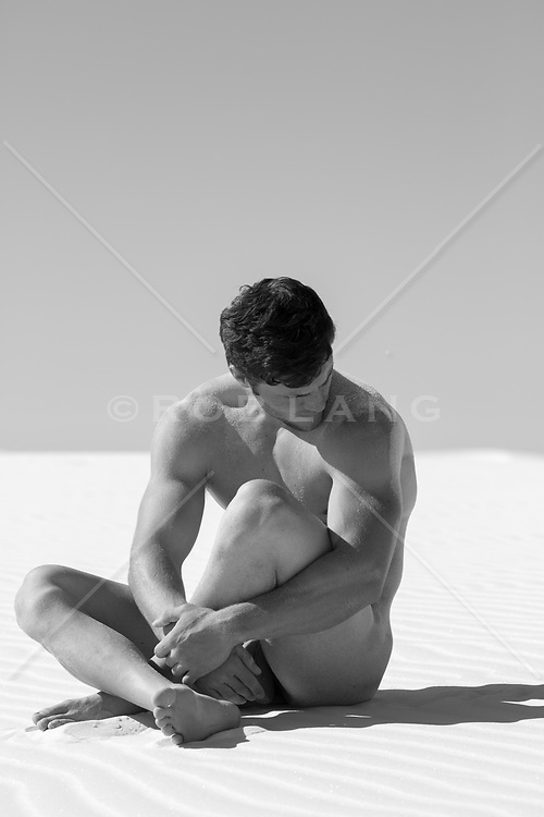 male nude in sand