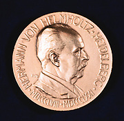 Hermann Ludwig Ferdinand von Helmholtz, 1907.  Helmholtz (1821-1894), German physicist and physiologist, inventor of the ophthalmascope (1850), was distinguished in a number of fields including mathematics and mathematical and experimental physics. Obverse of a commemorative medal struck to mark the International Physiological Congress in 1907.