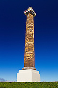 The Astoria column against a blue sky in August of 2013 in Astoria, Oregon.
