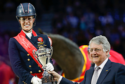 Podium Final Lyon 2014<br /> 1. Dujardin Charlotte - Valegro<br /> and John McEwen FEI 1st Vice President<br /> Reem Acra FEI World Cup™ Dressage Final 2013/2014<br /> Lyon 2014<br /> © Dirk Caremans