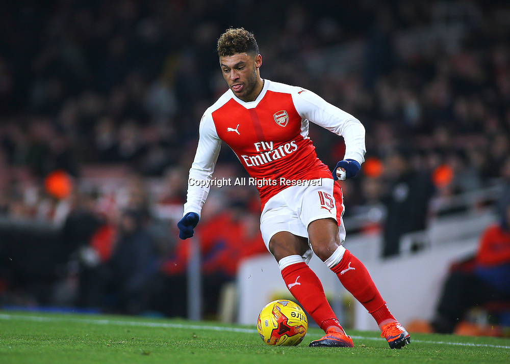 30.11.2016. Emirates Stadium, London, England. EFL Cup Football, Quarter Final. Arsenal versus Southampton. Arsenal's Alex Oxlade-Chamberlain brings the ball forward