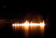 "17 February, 2006 - Anchorage, AK:  Flames erupt from the ice prior to the Alaska Aces 5-1 victory over the visiting Long Beach IceDogs at Sullivan Arena.  This season, the Alaska Aces theme is ""Ignite the Ice"""
