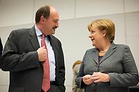 DEU, Deutschland, Germany, Berlin, 13.12.2011:<br />Dr. Michael Meister (CDU), stellv. Fraktionsvorsitzender der CDU/CSU-Fraktion, im Gespr&auml;ch mit Bundeskanzlerin Angela Merkel (CDU) vor Beginn der CDU/CSU-Fraktionssitzung im Deutschen Bundestag.
