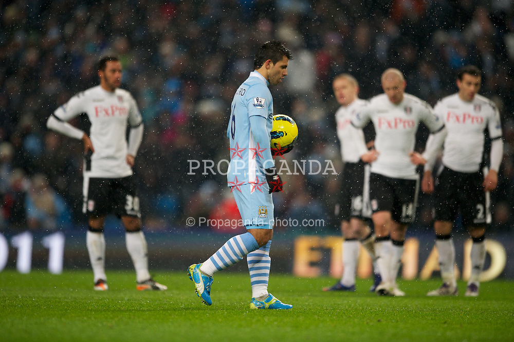LONDON, ENGLAND - Sunday, February 04, 2012: Manchester City's Sergio Aguero prepares to place the ball down on the penalty spot during the Premiership match at the Etihad Stadium. (Pic by Chris Brunskill/Propaganda)