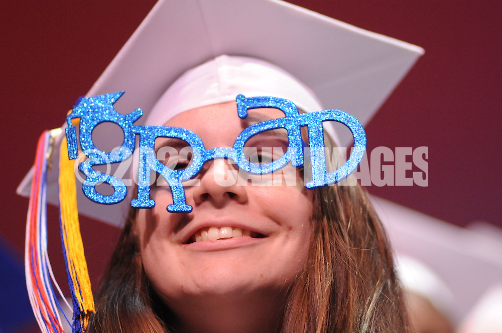 """Jeraca Marsh wears """"GRAD"""" glasses onstage during  Burlington County Institute of Technology's commencement ceremony Thursday June 18, 2015 in Medford, New Jersey.  (Photo by William Thomas Cain)"""