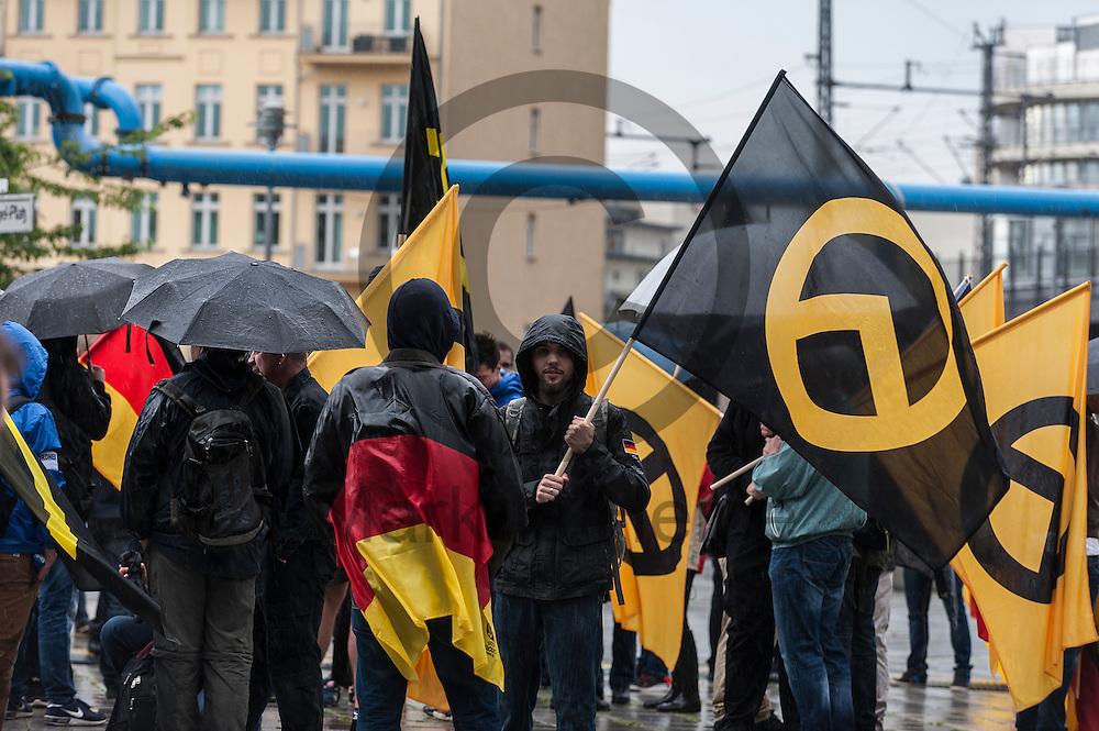 Teilnehmer halten w&auml;hrend der Demonstration der rechtsextremen Identit&auml;ren Bewegung am 17.06.2016 in Berlin, Deutschland Fahnen in der Hand. Mehre hundert Menschen demonstrierten gegen den ersten Marsch der rechtsextremen Identit&auml;ren Bewegung in Deutschland. Foto: Markus Heine / heineimaging<br /> <br /> ------------------------------<br /> <br /> Ver&ouml;ffentlichung nur mit Fotografennennung, sowie gegen Honorar und Belegexemplar.<br /> <br /> Bankverbindung:<br /> IBAN: DE65660908000004437497<br /> BIC CODE: GENODE61BBB<br /> Badische Beamten Bank Karlsruhe<br /> <br /> USt-IdNr: DE291853306<br /> <br /> Please note:<br /> All rights reserved! Don't publish without copyright!<br /> <br /> Stand: 06.2016<br /> <br /> ------------------------------