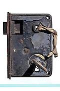 studio still life of an old rusty door lock with key
