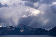 Sunlit rain downpour from strom clouds, Crater Lake National Park, Oregon