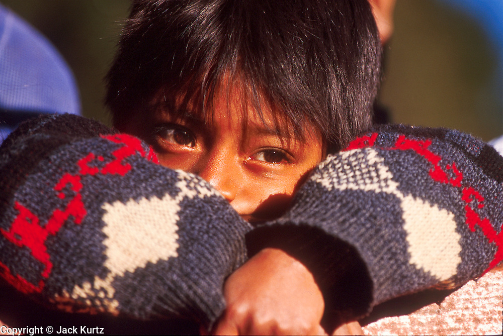 SAN CRISTOBAL DE LAS CASAS, CHIAPAS, MEXICO: A Mexican Indian child fleeing fighting between Zapatista guerillas and the Mexican army during the Zapatista uprising near Tenejapa, Chiapas, Mexico, Jan. 6, 1994. The Zapatistas captured and held San Cristobal for about a day at the beginning of the uprising.   ©  JACK KURTZ   MILITARY  ZAPATISTAS   POVERTY  INDIGENOUS    CULTURE    LAND ISSUES  refugees