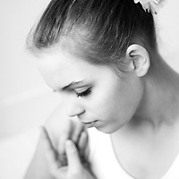 Close up of a young girl with flowers in her hair in ballet dress