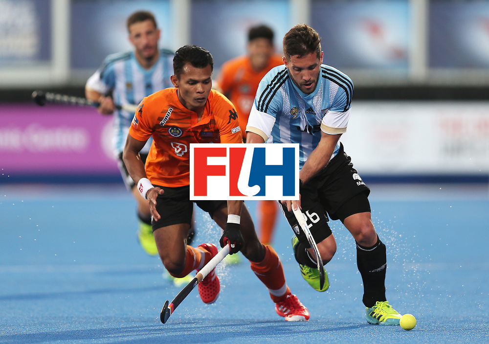 LONDON, ENGLAND - JUNE 16: Nabil Noor of Malaysia challenges Agustin Mazzilli of Argentina during the Pool A match between Argentina and Malaysia on day two of Hero Hockey at Lee Valley Hockey and Tennis Centre on June 16, 2017 in London, England.  (Photo by Alex Morton/Getty Images)
