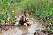 Janine Mureketete aged 9. Collecting water from an off shoot of Akagera river. (swamp) Juru Sector. Bugesera district<br /> <br /> &copy; Zute Lightfoot