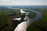 Nederland, Overijssel, Zwolle, 03-10-2010; de IJssel ter hoogte van Westenholte (linksboven). In het kader van het programma Ruimte voor de rivier zal de dijk landinwaarts verlegd worden. Ook worden er geulen gegraven die zullen aansluiten op de bestaande geul (onder in beeld). Door de dijkverlegging worden de uiterwaarden breder en krijgt de rivier meer ruimte..River IJssel north of Zwolle. There are plans to move the river dike (on the left) more inland and new 'channels' will be dug that will connect with the existing channel. Moving the dike will broaden the floodplains creating more space for the river..luchtfoto (toeslag), aerial photo (additional fee required).foto/photo Siebe Swart