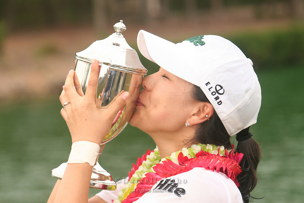 February 18, 2006; Kahuku, HI - Joo Mi Kim kisses her trophy during the awards ceremony after winning the LPGA SBS Open at Turtle Bay Resort...Mandatory photo credit: Darrell Miho.© Darrell Miho