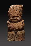 Tiki statue in red volcanic rock, 120cm tall,  from the Marae Pouau, Atuona on Hiva Oa, Marquesas Islands, gifted to the museum in 1935, in the Musee de Tahiti et des Iles, or Te Fare Manaha, at Punaauia, on the island of Tahiti, in the Windward Islands, Society Islands, French Polynesia. Tikis are protective statues representing Ti'i, a half-human half-god ancestor who is believed to be the first man. The Museum of Tahiti and the Islands was opened in 1974 and displays collections of nature and anthropology, habitations and artefacts, social and religious life and the history of French Polynesia. Picture by Manuel Cohen