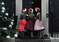 © Licensed to London News Pictures. 12/12/2011, London, UK.Children's entertainers dressed as 1940's Land Girls on the doorstep at 10 Downing Street today, Monday 12th December 2011. The Primeminister is hosting a christmas party for children today. Photo credit : Stephen Simpson/LNP
