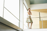 Businesswoman talking on cell phone on Mezzanine