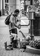 Friends greet on the street during rush hour, on the corner of Trade and Tryon in Uptown Charlotte