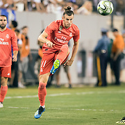 MEADOWLANDS, NEW JERSEY- August 7:  Gareth Bale #11 of Real Madrid plays a through ball for Marco Asensio #20 of Real Madrid to score his sides first goal during the Real Madrid vs AS Roma International Champions Cup match at MetLife Stadium on August 7, 2018 in Meadowlands, New Jersey. (Photo by Tim Clayton/Corbis via Getty Images)