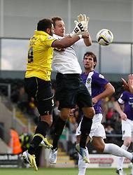 Oxford United's Ryan Clarke drops the ball under pressure from Burton Albion's Rene Howe  - Photo mandatory by-line: Matt Bunn/JMP - Tel: Mobile: 07966 386802 07/09/2013 - SPORT - FOOTBALL -  Pirelli Stadium - Burton upon Trent - Burton Albion V Oxford United - Sky Bet League Two