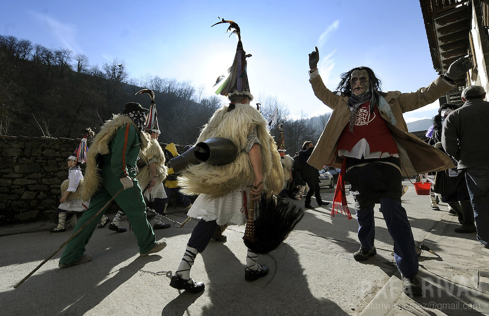 "A group of ""Joaldunak"" (""those who play the bell"") march carrying big cowbells tied to their backs as they take part in the ancient carnival of Ituren, in the northern Spanish province of Navarra province, on January 30, 2012."