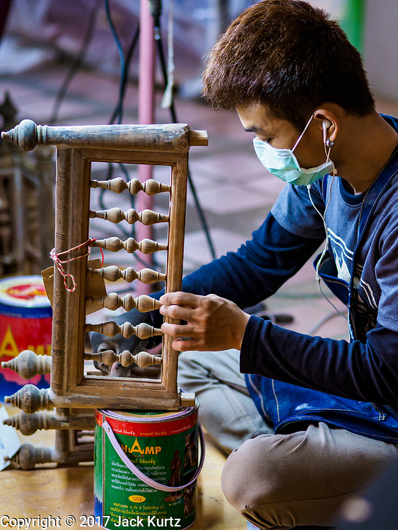 19 JULY 2017 - BANGKOK, THAILAND: Craftsmen at the National Museum in Bangkok paint and repair the royal chariots that will be used in the funeral procession of Bhumibol Adulyadej, the Late King of Thailand. The King, also known as Rama IX, was the ninth of the King of the Chakri Dynasty and died after a long illness on October 13, 2016. He will be cremated on October 26, 2017.        PHOTO BY JACK KURTZ