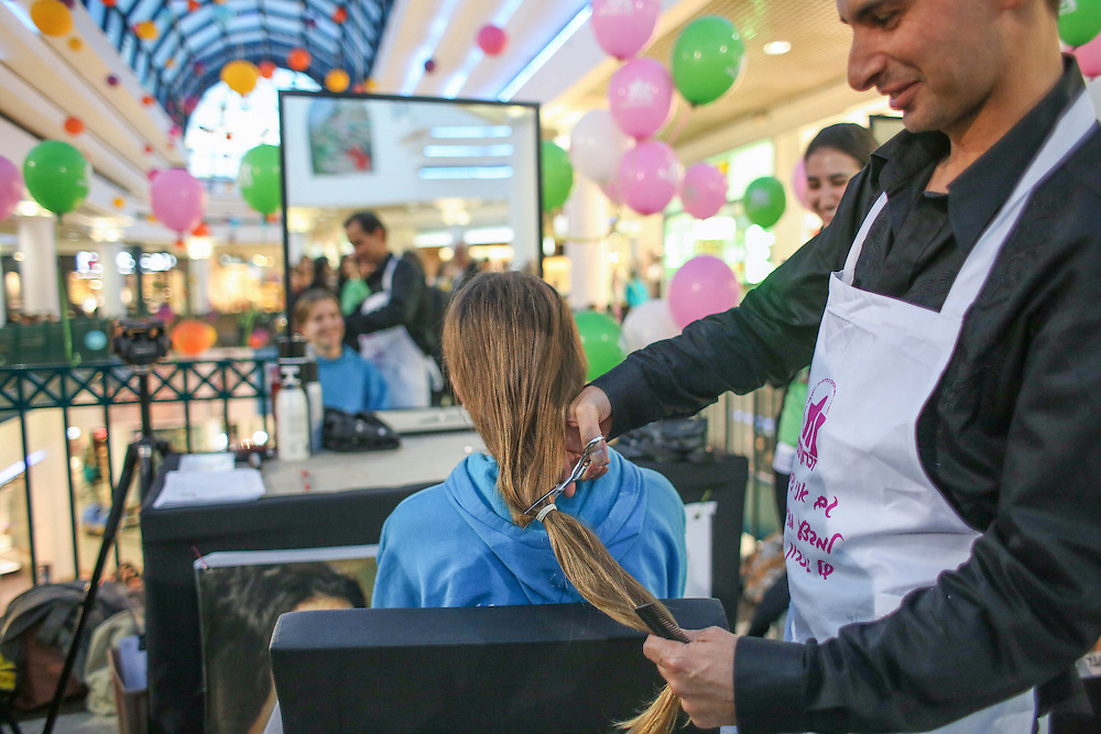 "Young Israeli woman arrive to donate hair to create wigs for cancer patients, this operation arranged by ""Zichron Menachem"" the The Israeli Association for the Support of Children with Cancer and their Families.  November 25, 2012.   Photo by Oren Nahshon"