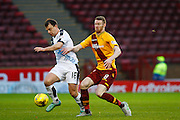 Dundee FC Forward Paul McGowan takes on Motherwell FC Midfielder Stephen Pearson during the Ladbrokes Scottish Premiership match between Motherwell and Dundee at Fir Park, Motherwell, Scotland on 12 December 2015. Photo by Craig McAllister.