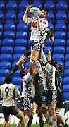 2005/06, European Challenge Cup, Agen's Damian Fevre, redireects the line out ball, challenged by Exiles Nick Kennedy. London Irish vs Agen,  Madejski Stadium, Reading, ENGLAND   © Peter Spurrier/Intersport Images - email images@intersport-images..   [Mandatory Credit, Peter Spurier/ Intersport Images].