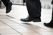 close up and low point view of business people walking