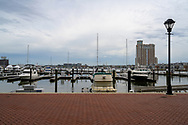 Baltimore, MD, USA --April 13, 2019-- Wide-angle shot of boats docked in a marina in Baltimore's inner harbor.