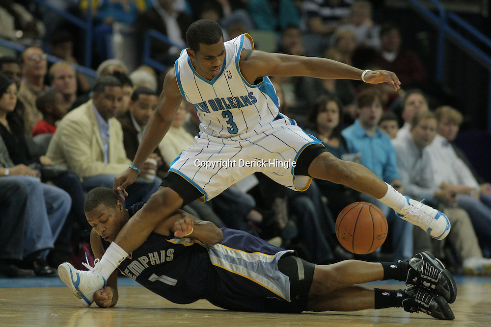 06 December 2008:  New Orleans Hornets guard Chris Paul (3) and Memphis Grizzlies guard Kyle Lowry (1) scramble for a loose ball during the third quarter of a NBA game between the Memphis Grizzlies and the New Orleans Hornets at at the New Orleans Arena in New Orleans, LA..