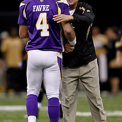 September 9, 2010; New Orleans, LA, USA; Minnesota Vikings quarterback Brett Favre (4) is greeted by New Orleans Saints head coach Sean Payton during warm ups prior to kickoff of the NFL Kickoff season opener at the Louisiana Superdome. The New Orleans Saints defeated the Minnesota Vikings 14-9.  Mandatory Credit: Derick E. Hingle